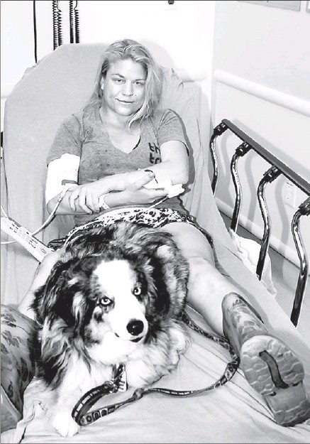 "??  ?? TERRA re­cov­er­ing af­ter the at­tack. Her sturdy thick-tread rain boots, which she had worn to work that day at the dog ken­nel, may have helped save her life. ""I'm re­ally, re­ally sorry,"" she told her mom. ""I think I killed your hus­band."" Po­lice called it..."