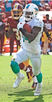 ?? BRAD MILLS, USA TODAY SPORTS ?? Jarvis Landry had a big game for the Dolphins in their victory against the Redskins.