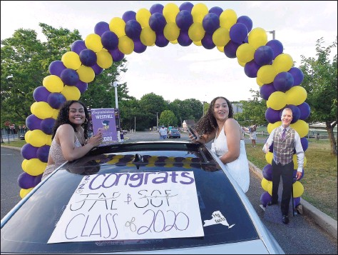 ?? Hearst Connecticut Media file photo ?? Parents, families and friends — along with a cut-out of Principal Michael Rinaldi — cheer on the seniors of Westhill High School as 500-plus graduates parade into the school parking lot to celebrate the Class of 2020 on June 19, 2020, in Stamford.