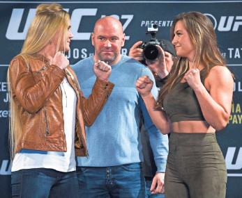 ??  ?? UFC President Dana White is flanked by foes Holly Holm, left, and Miesha Tate. L.E. BASKOW, AP