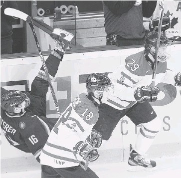 ?? NATHAN DENETTE/THE CANADIAN PRESS ?? Team Canada forward Jonathan Drouin, right, takes out German defenceman Florin Ketterer, left, as Canada's Ryan Strome, centre, skates past during the first period of their IIHF World Junior Championships game in Ufa, Russia.
