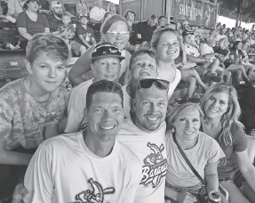 ?? NATHAN DOMINITZ/SAVANNAHNOW.COM ?? From left, back row: Gavin Wortman, 14; Traven Neemann, 12; Tenley Neemann, 9; Trace Neemann, 8; Olivia Wortman, 10. Front row: Jeremy Wortman, Travis Neemann, Bridgette Neemann, Kristin Wortman at the Savannah Bananas' home game July 1.