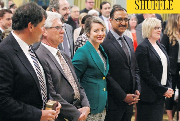 ?? PATRICK DOYLE/THE CANADIAN PRESS ?? Dominic LeBlanc, from left, Jim Carr, Mélanie Joly, Amarjeet Sohi and Carla Qualtrough attend a swearing-in ceremony at Rideau Hall in Ottawa on Wednesday.