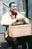 ?? AL LEVINE/NBC ?? Eddie Murphy portrays Mr. Robinson during a Mister Robinson's Neighborhood skit on Saturday Night Live in May 1983.
