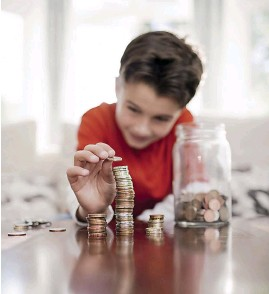 ??  ?? Encourage your child to set aside money for a particular thing