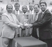 ?? — ASIAN AGE ?? S. Ram Kumar Reddy ( right) presents the Deccan Bookmakers Colts Championship Stakes ( Grade III) trophy to trainer S. Ganapathy ( left) after Bold Majesty won the main event in Hyderabad on Monday.