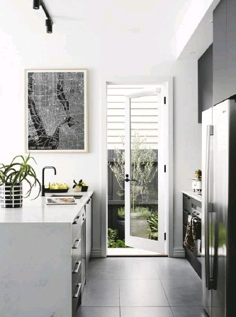 """??  ?? KITCHEN (above) """"I designed the kitchen, anda Darren spent endless hours making the cabinetry,"""" says Sal. """"It's really a stand- out feature of the extension."""" LIVING & DINING AREA (opposite) French doors with full-length windows invite the outside in,..."""