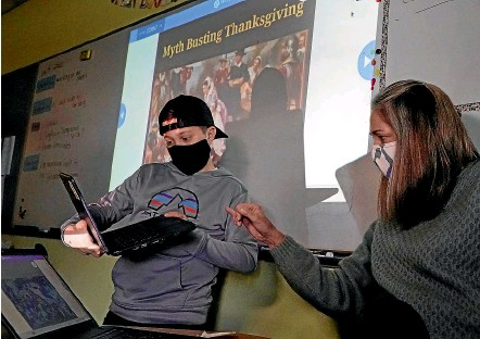 ?? AP ?? Massachusetts teacher Susannah Remillard works with one of her pupils on a new type of Thanksgiving history lesson, which gives greater prominence to Native Americans after decades of lessons that focused on the English ''Pilgrim'' settlers who arrived in North America in 1620.