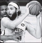 ?? THE ASSOCIATED PRESS ?? Senior guard Blake Francis (left) leads Richmond with 16.1 points per game followed by senior forward Grant Goldenwith 14.8. All UR starters average in double figures.