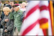 ?? CHRISTOPHER DOLAN / STAFF PHOTOGRAPHER ?? Julie Nicholas and veteran Joe Talarico, 87, both of Scranton, stand Monday during the national anthem at the annual Koch-conley American Legion Post Veterans Day program on Courthouse Square in Scranton.
