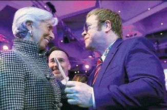 ??  ?? No business like showbusiness: Head of the IMF Christine Lagarde talks with Elton John, above; Theresa May, right, is due to speak at the World Economic Forum, and, below Cate Blanchett yesterday received an entrepreneurship award