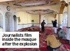 ??  ?? Journalists film inside the mosque after the explosion