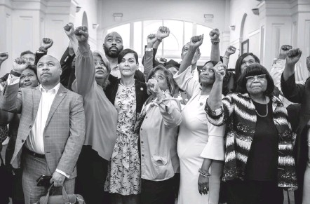 ?? PHOTOS BY BILL O'LEARY/THE WASHINGTON POST ?? Members of the Texas Legislative Black Caucus raise their fists Friday as they pose for a snapshot in Alexandria, Va. Nearly 60 Democrats fled the state to prevent a quorum and thwart passage of voting restrictions by the Republican-controlled House.