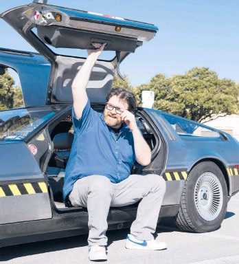 """?? BEN SKLAR/THE NEWYORKTIMES ?? Ernest Cline, an enthusiast of 1980s geek culture and author of""""Ready Player Two,""""with his DeLorean in Austin, Texas, in 2016."""