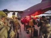 ?? MASTER SGT. ALEXANDER BURNETT US Army via AP ?? In this image provided by the U.S. Army, paratroopers assigned to the 82nd Airborne Division and others prepare to board a C-17 cargo plane at Hamid Karzai International Airport in Kabul, Afghanistan, Monday.