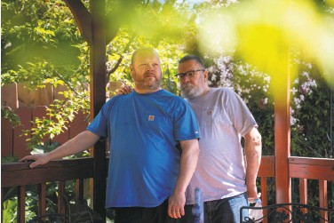 ?? Sarahbeth Maney / Special to The Chronicle ?? Chad Baker (left), an emergency room nurse at Kaiser Richmond, and husband Tom Baker, who has respiratory problems and an immune system disorder, had to separate for 14 months as a health safeguard.