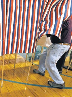 ?? ELISE AMENDOLA, AP ?? A voter enters a booth at a polling place in Exeter, N. H., on Nov. 8.