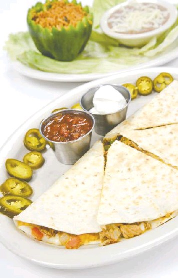 ?? MARK GILLILAND PHOTOS ?? Diners can choose from beef, chicken, steak or cheese quesadillas at Track's End with two sides of choice.