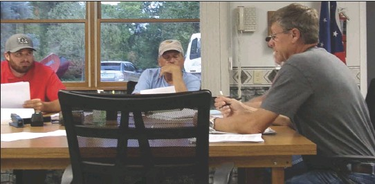 ??  ?? Duchouquet Township Zoning Inspector Tom Doorley, right, reviews potential residential solar regulations with trustees during a recent meeting.