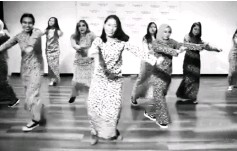 """??  ?? A group of Malaysian girls clad in Baju Kurung and canvas sneakers dancing to """"Panama"""" in a video shared on the Raja Lepak Facebook page."""