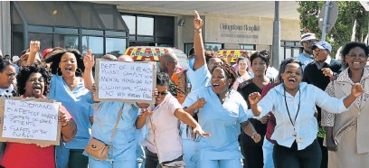 ?? PHOTOGRAPH: EUGENE COETZEE ?? AT WITS' END: Nursing staff protest outside Livingstone Hospital after a fellow nurse was attacked by a mental health patient at the accident and emergency unit earlier this week. Staff are worried about their own safety and that of their patients