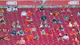 ?? JASON BEHNKEN/ASSOCIATED PRESS FILE ?? Ex-Tampa Bay Bucs star Warren Sapp says it's sad Bucs backers won't be able to fill their home stadium for the Super Bowl. Only 22,000 socially distanced fans will be admitted.