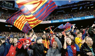 ??  ?? Barcelona fans celebrate the team's win against Real Madrid.