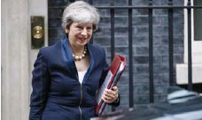 ?? TOLGA AKMEN/AFP/GETTY IMAGES ?? Britain's Prime Minister Theresa May will meet with Justin Trudeau on Monday. The two leaders have found common ground on protecting jobs.