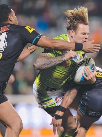 ??  ?? HAIR RAIS­ING: Blake Austin was one of Can­berra's best be­fore his shoul­der in­jury in the 50th minute; Jack Wighton's tackle that ended Jamie Soward's night (be­low).