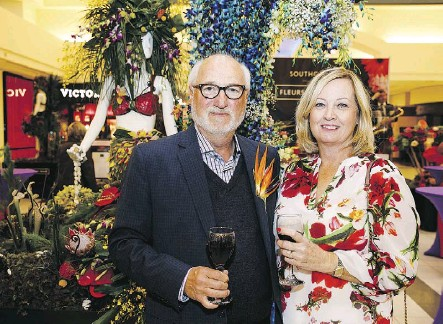 ??  ?? Howard Worrell of Flowers by Merle poses with Lynn Catena. Fleurs de Villes celebrates local designers by bringing together flowers and fashion. The event is a festive reminder that spring is in full swing.