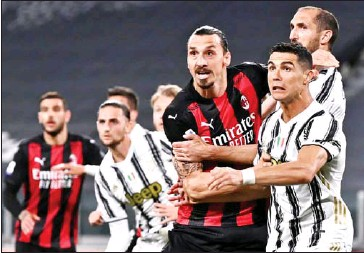 ?? AFP ?? AC Milan's Swedish forward Zlatan Ibrahimovic (centre) and Juventus' Portuguese forward Cristiano Ronaldo (right) eye the ball during the Italian Serie A football match on May 9.
