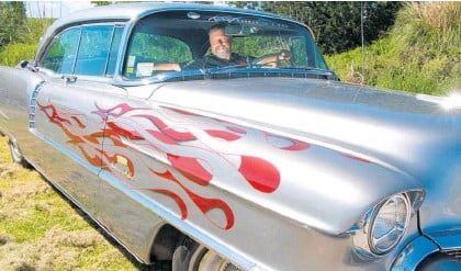 ??  ?? Pukehina's Stu Brickland behind the wheel of his 1956 Cadillac Sedan de Ville he will be driving to Beach Hop.