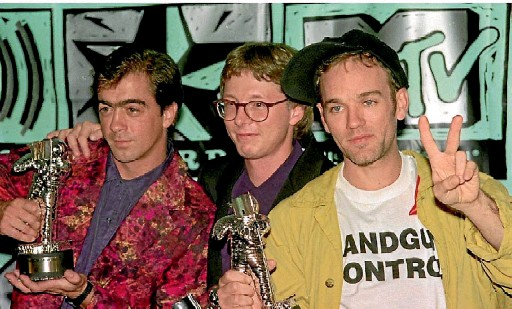 ??  ?? Bill Berry, Mike Mills and Michael Stipe at the height of REM's fame in 1991.