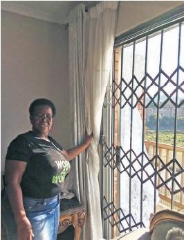 ??  ?? Hlakaniphile Lukhele points to the shattered sliding door glass