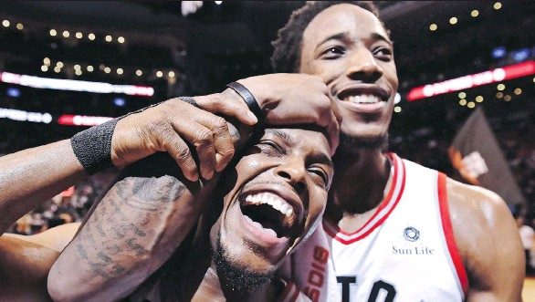 ?? FRANK GUNN/THE CANADIAN PRESS ?? Raptors guard Kyle Lowry, left, will have to get along without DeMar DeRozan, who was shipped to the Spurs on Wednesday as part of the Leonard trade.