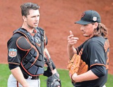 ?? PHOTOS BY RICK SCUTERI, USA TODAY SPORTS ?? Catcher Buster Posey aims to quickly find a comfort level with newcomers Jeff Samardzija, right, and Johnny Cueto.