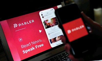 ?? Photograph: Olivier Douliery/AFP/Getty Images ?? Parler was banned from Apple's App Store and the Google Play store in January.