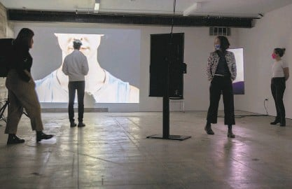"""?? Photos by Santiago Mejia / The Chronicle ?? CounterPulse staff members take part in a dress rehearsal last month for """"are:era,"""" top, and """"Human/ID,"""" the two installations being presented as part of Combustible Residency 2021."""