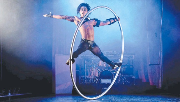 ??  ?? HOOP STAR: Leo Sanchez's acrobatic performance is one of many highlights in Brisbane Festival's Fear & Delight show in the big top. Picture: Liam Kidston