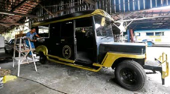 """?? PHOTOS BY LYN RILLON ?? Customized jeepneys take shape at the Sarao Motors workshop in Barangay Pulang Lupa, Las Piñas City, including a """"retro"""" model (left) based on the first units produced by the company founder Leonardo Sarao in the 1950s.—"""