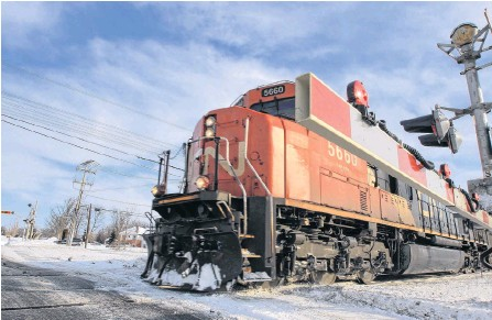 ?? REUTERS ?? A CN Rail train travels westward on a track in Montreal.