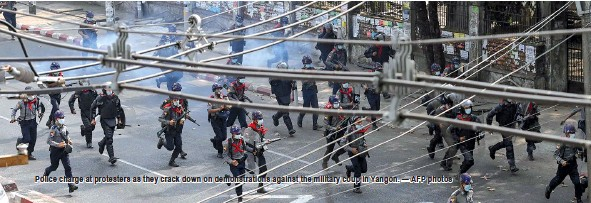 ?? — AFP photos ?? Police charge at protesters as they crack down on demonstrations against the military coup in Yangon.