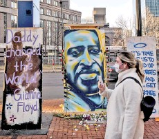 ?? — AFP file photo ?? A painting of Floyd outside the Hennepin County Government Centre in Minneapolis, Minnesota.
