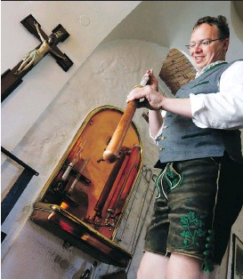 ?? PHOTOS: MATTHIAS SCHRADER/ THE ASSOCIATED PRESS ?? Brewer Michael Gilg controls a sample of wort in his brewery Griessbraeu in Murnau, Germany Thursday. Germany celebrated on Friday 500 years of a German beer purity law, signed by Duke William IV of Bavaria in 1516.