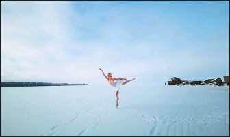?? ALEXANDER SOKOLOV / TASS ?? Ballet dancer Ilmira Bagautdinova on Tuesday dances on the frozen Batareinaya Bay in the Gulf of Finland, where a grain terminal is to be constructed. The dancer wants to draw attention to the need to save the beach, in Russia's Leningrad region, from development.