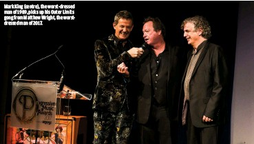 ??  ?? MARK KING (CEN­TRE), THE WORST-DRESSED MAN OF 1989, PICKS UP HIS OUTER LIM­ITS GONG FROM MATTHEW WRIGHT, THE WORSTDRESS­ED MAN OF 2017.