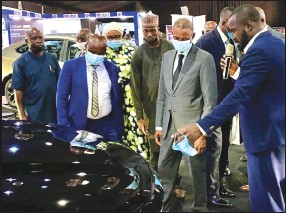 ??  ?? •Jimoh (right) explaining the car features to Aliyu (second right) and other guests at the fair.