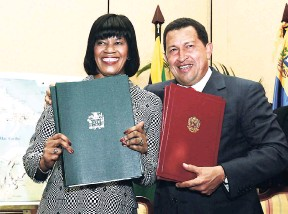 ?? FILE ?? Then Venezue­lan Pres­i­dent Hugo Chávez, now de­ceased, poses with Prime Min­is­ter Por­tia Simp­son Miller af­ter sign­ing the PetroCarib­e Agree­ment in Mon­tego Bay, St James, in 2005. Venezuela signed ac­cords to in­crease oil and fuel sup­plies to Ja­maica and...