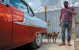 ?? — AFP ?? Panel beater Manso checking a Chevrolet Belair 55 car rebuilt by him in his workshop in the town of Placetas, Villa Clara province, central Cuba.