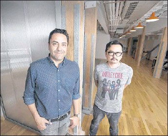 ?? Allen J. Schaben Los Angeles Times ?? SODA CREATIVE is one of several companies that have sprouted up to take advantage ofmovie studios' appetite for targeted marketing. Above, owner Jaime Gamboa, left, and business partner Jaehoon Oh.